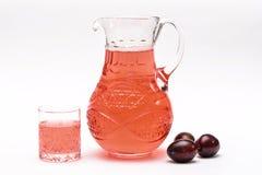 Compota fresca das ameixas no filtro Fotografia de Stock Royalty Free