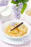 Compote of apples and pears with vanilla, yogurt and lilac Royalty Free Stock Photo