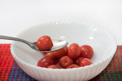Compote of cherries in a bowl and cherry on the spoon Royalty Free Stock Photography