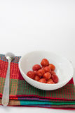 Compote of cherries in a bowl with spoon Stock Image