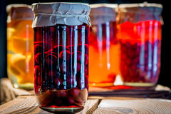 Compote of cherries in a glass jar stock photo