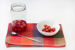Compote of cherries in a jar with compote in a bowl on the kitch Royalty Free Stock Photo
