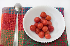 Compote of cherries in white bowl on the kitchen tablecloth Stock Photo