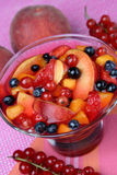 Compote with fruit. On plate Royalty Free Stock Image