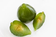 Compote of green figs. Delicious dessert served with sweet pumpkin and cheese royalty free stock image