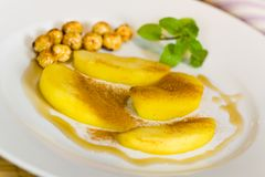 Compote of Pears , with caramelized hazelnuts Stock Photography