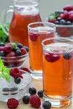 Compote of raspberries, strawberries and blueberries. Royalty Free Stock Photography