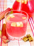 Compote from rhubarb in glassful and pitcher Royalty Free Stock Images