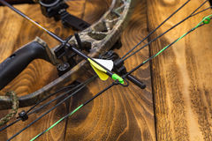 Compound hunting bow. Camouflage compound hunting bow with arrow Stock Photo