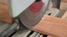 Compound miter saw cutting a piece of wood in carpentry workshop.  stock video footage