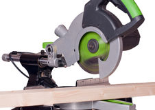 Compound mitre saw. Sliding compound mitre saw and timber Royalty Free Stock Images
