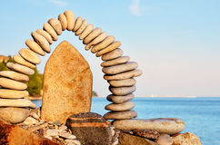 Compound of stones. Stones laid out in the form of a arch on the sea coast Stock Image