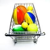 Compra brinquedos dos esportes imagem de stock