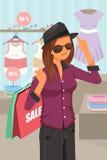 Compra da mulher dentro da loja de roupa Imagens de Stock