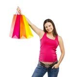 Compra da mulher gravida isolada no branco Imagem de Stock Royalty Free