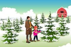 Compra do pai e do filho para uma árvore de Natal Fotografia de Stock