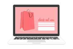 A compra em linha na verificação para fora pagina com saco de compras Fotografia de Stock