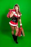 Compra 'sexy' da menina de Santa Fotos de Stock Royalty Free