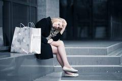 Comprador joven triste Foto de archivo libre de regalías