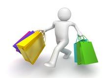 Comprador que recorre con las bolsas de papel Foto de archivo libre de regalías