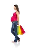 Compras de la mujer embarazada aisladas en blanco Imágenes de archivo libres de regalías
