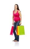 Compras de la mujer embarazada aisladas en blanco Imagen de archivo