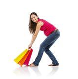 Compras de la mujer embarazada aisladas en blanco Imagen de archivo libre de regalías