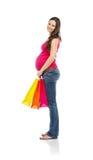 Compras de la mujer embarazada aisladas en blanco Fotos de archivo