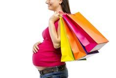 Compras de la mujer embarazada aisladas en blanco Foto de archivo