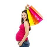 Compras de la mujer embarazada aisladas en blanco Foto de archivo libre de regalías