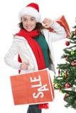 Compras de la mujer en la Navidad fotografía de archivo