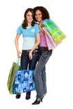 Compras de la mujer joven, aisladas en blanco Fotografía de archivo libre de regalías