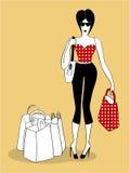 Compras de la mujer joven con los bolsos Imagen de archivo