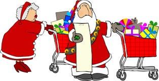 Compras de Santa y de señora Claus Fotografía de archivo libre de regalías