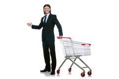 Compras del hombre con el carro de la cesta del supermercado Imágenes de archivo libres de regalías