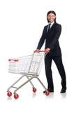 Compras del hombre con el carro de la cesta del supermercado Foto de archivo