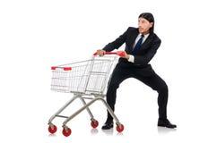 Compras del hombre con el carro de la cesta del supermercado Fotos de archivo libres de regalías
