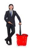 Compras del hombre con el carro de la cesta del supermercado Fotografía de archivo