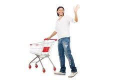 Compras del hombre con el carro de la cesta del supermercado Imagen de archivo