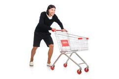 Compras del hombre con el carro de la cesta del supermercado Imagen de archivo libre de regalías