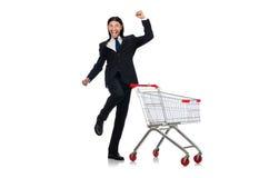 Compras del hombre con el carro de la cesta del supermercado Foto de archivo libre de regalías