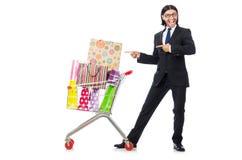 Compras del hombre con el carro de la cesta del supermercado aislado Imágenes de archivo libres de regalías