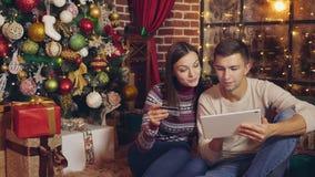 Compras en línea de la Navidad, hogar almacen de metraje de vídeo
