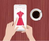 Compras en línea de la ropa Fotos de archivo