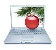 Compras en línea del ordenador de la Navidad Foto de archivo
