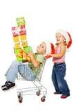 Compras felices de la Navidad de los cabritos Imagen de archivo