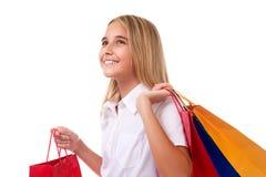Compras, venta, la Navidad y adolescente día de fiesta-feliz con los panieres, aislados Fotos de archivo libres de regalías