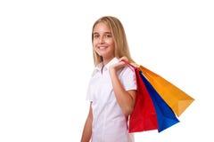 Compras, venta y chica joven día de fiesta-preciosa con los panieres, aislados Imágenes de archivo libres de regalías