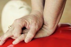 Compresiones del CPR Fotografía de archivo libre de regalías