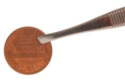 Compressão da moeda de um centavo Fotografia de Stock Royalty Free